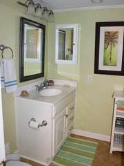 Off the entry hall is a full bath with a walk in shower.
