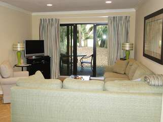 Sliding doors allow sunlight and access to a covered patio.