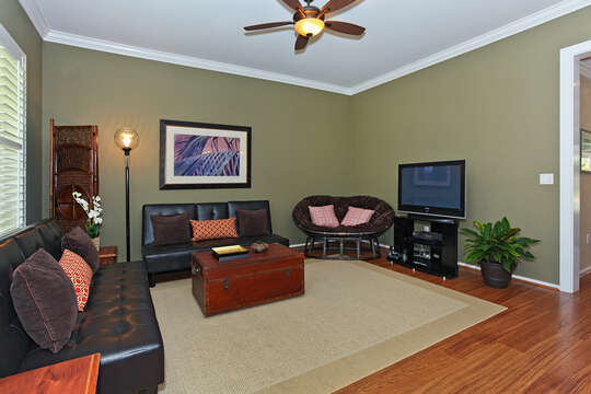 The Home has a Spacious Living Room with Large Flat Screen TV