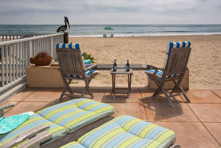 Sit and enjoy the view with toes in the sand!