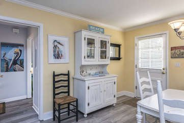 Upon entering through the front door, there is a great room area with the kitchen off to your left, guest bedrooms on your right, and the master bedroom in the back.