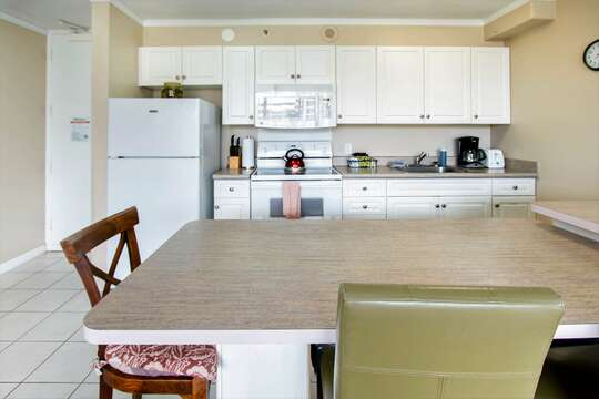 Fully furnished kitchen. Kitchen island to enjoy a family meal all without having to leave the comforts of your unit.