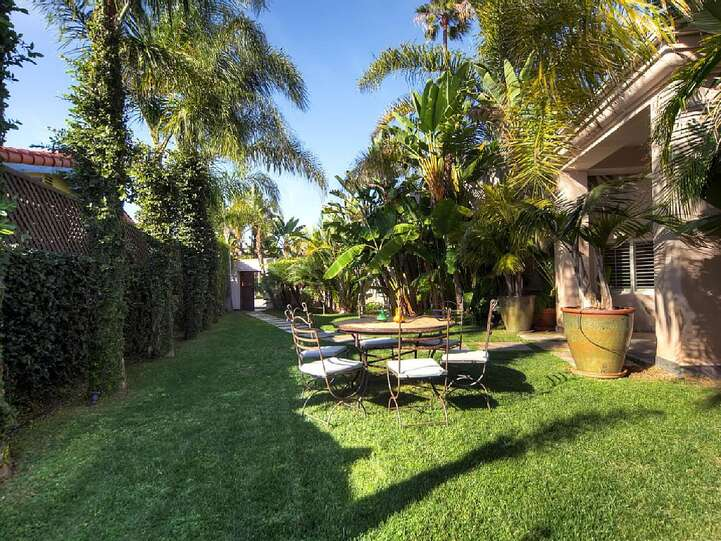 Gated side yard and front approach offers play space