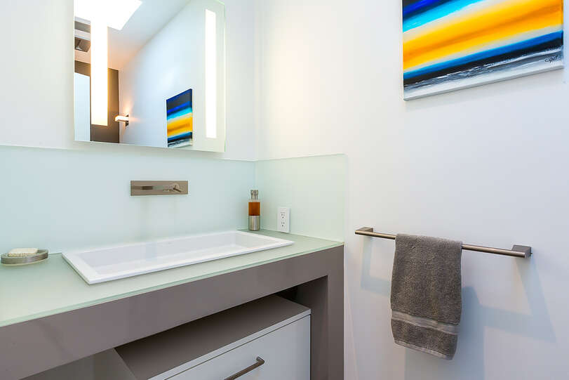 Even the half bath is elegantly adorned with modern touches