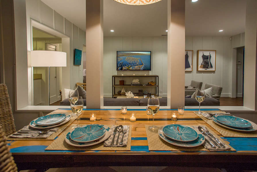 Colorful dishes adorn the custom dining table
