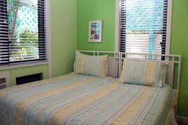 Twin beds converted to king in Bedroom 2 with natural light