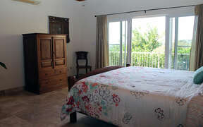 Large Lower Bedroom with access to deck and patio with view and breezes