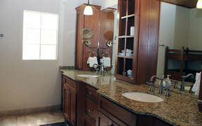 Well appointed bathroom with double sink and modern amenities