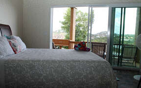 Bedroom with view and access to deck