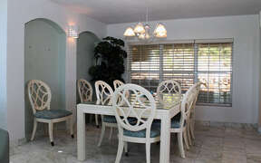 Dining area seats up to 8 guests with Window