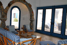 Magestic stone archways with view of pool deck and lounge area