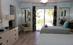 Very large bedroom with sliding door to pool area