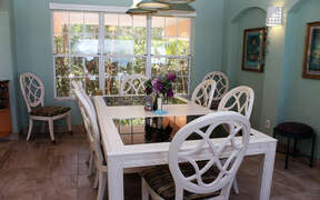 Large dining area with big windows for natural lighting