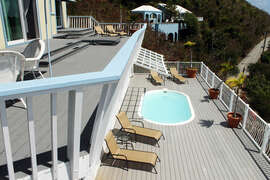 Looking down onto pool deck from 2nd floor balcony