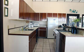 Full kitchen with tile floor and wood cabinets