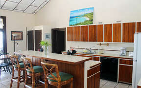 Full view of kitchen area with bar seating