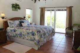 Master bedroom offers en suite bath and sliding doors to covered veranda