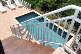 Steps lead from upper veranda to lower pool deck and bedroom.