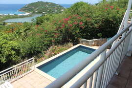 View of private pool and Caribbean Sea from upper veranda