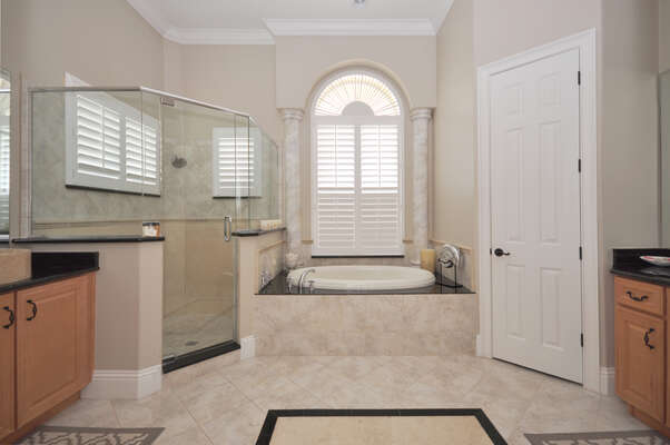 Enormous luxury en-suite bathroom with a Jacuzzi bath