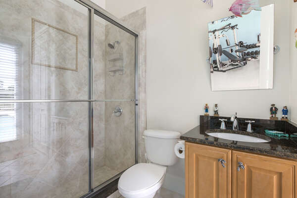 Full bathroom located in private gym