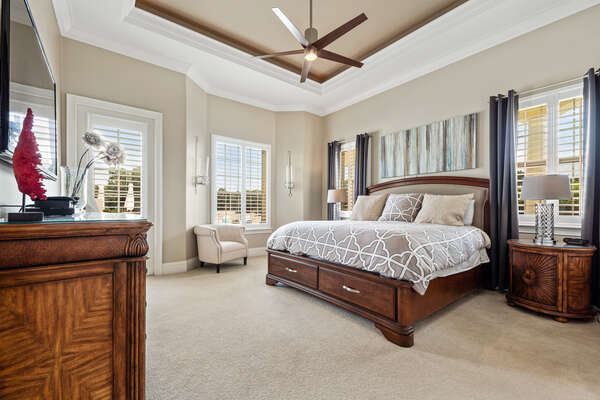 The 1st master bedroom is located on the ground floor. This spacious room has a King size bed, 60 inch LED TV, door that leads out to the pool and deck