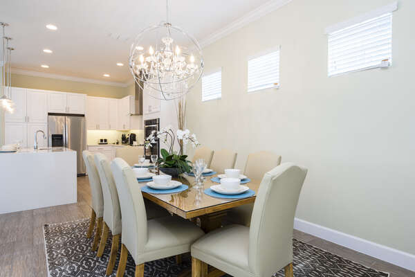 Enjoy family time around the formal dining table with seating for 8