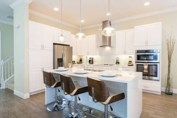 This modern kitchen with stainless appliances and breakfast bar comes fully equipped for any chef to be able to whip up their favorite meal