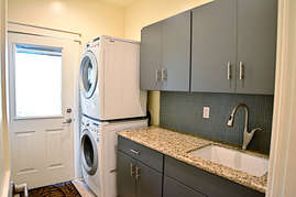 If things get a bit dirty no need to worry there is a fully stocked laundry room on the main floor.