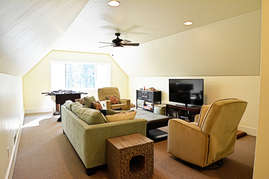 The bonus room features a luxurious couch, flat screen television, Foosball table and games for the kids.