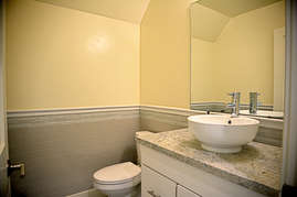 No need to walk downstairs there is a half bath in the bonus room for guests on the upper floor.