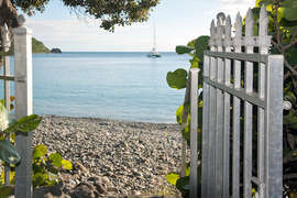 Walk right onto the beach from the gardens at Belle Mer
