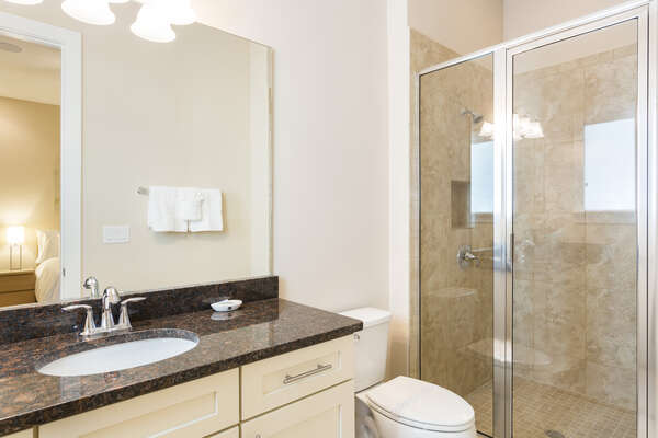 En-suite with granite counter tops and walk in shower