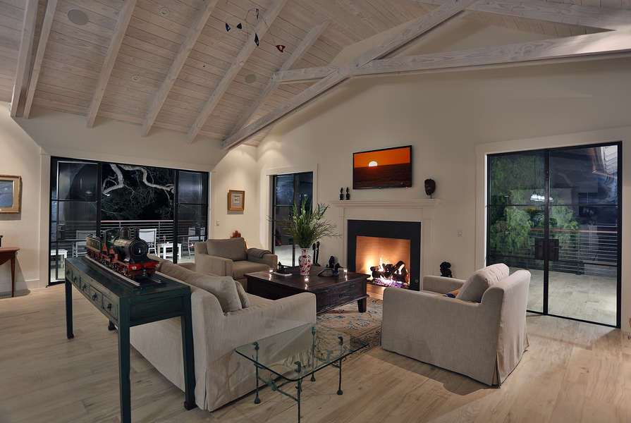 Living Room with fireplace opens to deck