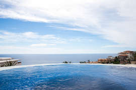 Sit in the pool and watch the whales pass in the distance
