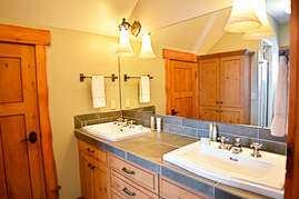 The third bathroom features a double vanity to accommodate multiple guests from the loft and third bedroom.