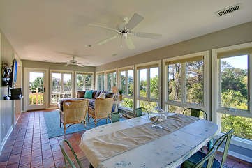 The sunroom is a wonderful retreat at the end of the day.