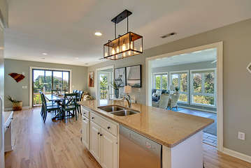 Enjoy the openness of the kitchen to the living area and sunroom.