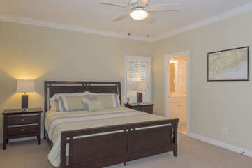 The master bedroom has a king bed and en-suite bath.