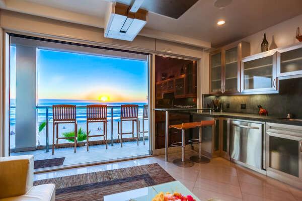 Kitchen opening up to patio, ocean breeze!