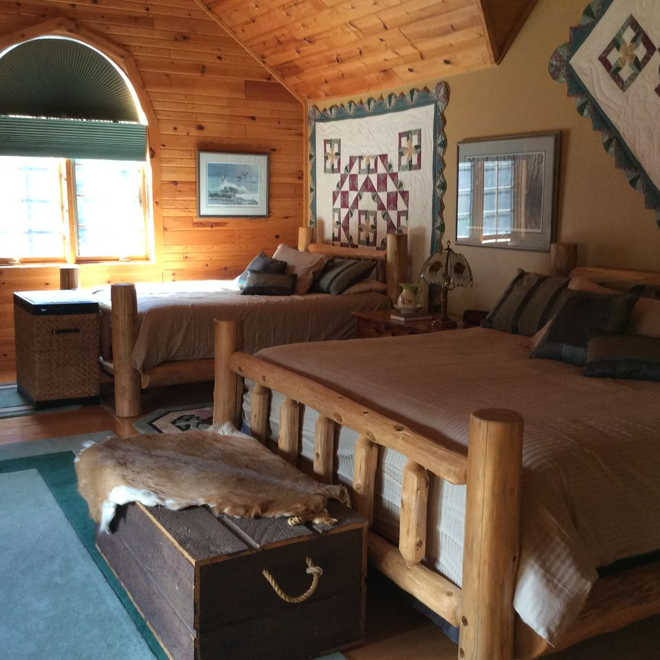 Upstairs Master bedroom with adjoining bathroom, with a king and double and a twin bed.