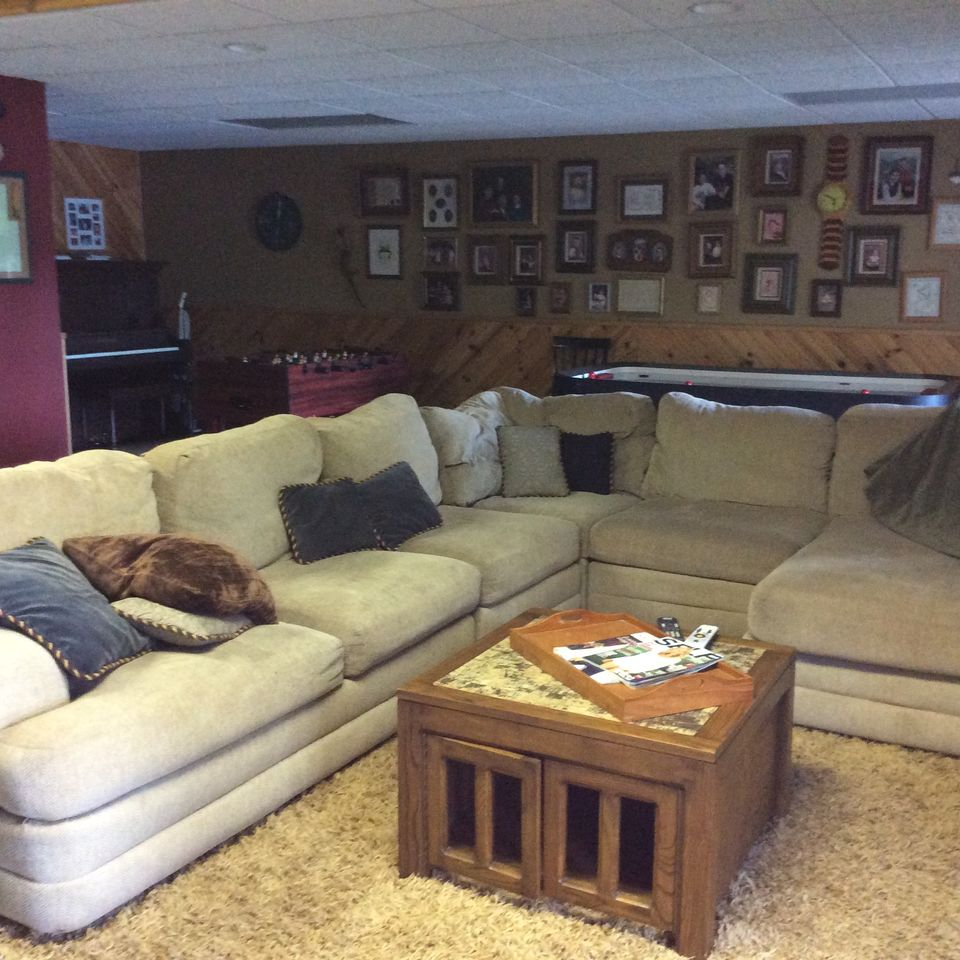 Lower level family room with TV and game tables, and access to lower patio.
