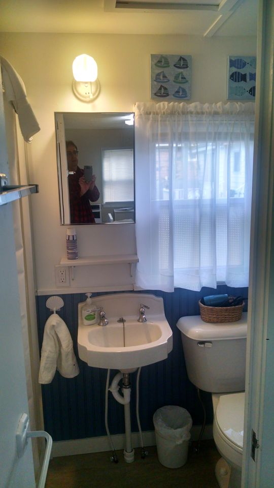 Completely remodeled bath with period correct sink, new stool and shower