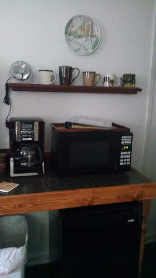Coffee, microwave and refrigerator with laundry on site