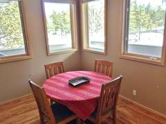 Breakfast nook or game/puzzle table (across the kitchen from dining area)