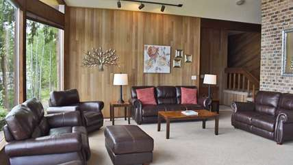 Large living room with leather couches