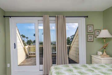 Sliding doors lead to the private second floor balcony. Gentle ocean breezes drift you off to sleep.