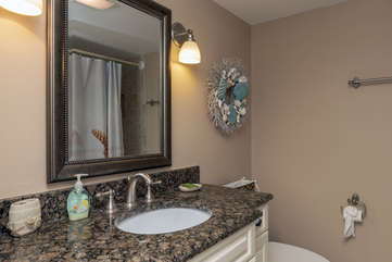 Off the hall is a full bath with a granite topped vanity.