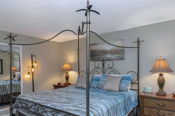 The 1st floor master bedroom has a king four post bed and updated bedding.