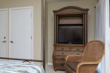 The armoire holds a large HDTV and your clothing.